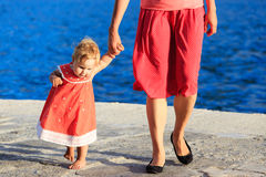 Little girl making first steps at the sea Stock Photography