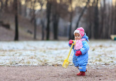 Little girl making first steps in winter Royalty Free Stock Photo