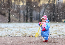 Little girl making first steps in winter park Stock Image