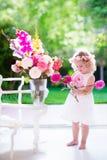 Little girl making flower arrangement Stock Images