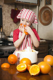 Little girl making fresh juice Stock Photography