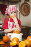 Little girl making fresh juice Royalty Free Stock Images