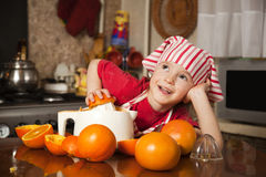 Little girl making fresh juice Royalty Free Stock Photos