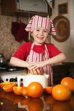 Little girl making fresh juice Stock Photos