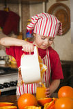 Little girl making fresh juice Royalty Free Stock Photo
