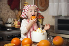 Little girl making fresh juice Stock Photo
