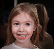 Little girl making funny face Stock Images