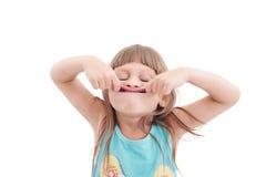 Little girl making funny face Stock Photo