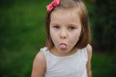 Little girl making funny face Royalty Free Stock Photo