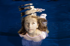 Little girl making funny face underwater Royalty Free Stock Photo