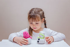 Little girl making handcraft snowman Royalty Free Stock Photography
