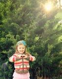 Little girl making heart symbol Stock Images