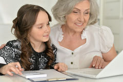 Little girl making homework with granny Royalty Free Stock Photos