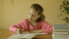 Little girl making homework stock footage