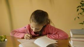 Little girl making homework stock video