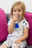 Little girl making inhalation Stock Photography