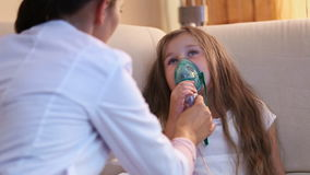 Little girl making inhalation stock footage