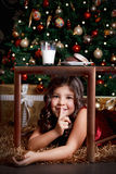 Little girl making a keep quiet gesture Royalty Free Stock Images