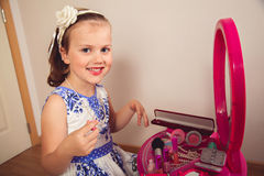 Little girl making makeup Royalty Free Stock Images