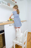 Little girl making meal. Stock Photos