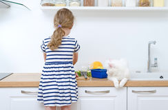 Little girl making meal. Stock Images