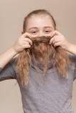 Little girl making  moustache Stock Photos