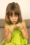 Little girl making a necklace Royalty Free Stock Photos