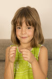 Little girl making a necklace Stock Photo