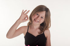 Little girl making OK sign with hands Royalty Free Stock Photography