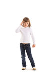 Little girl making phone call. Using smartphone on white background Stock Images