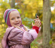 Little girl making photo or video with smartphone. Royalty Free Stock Photo