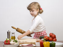 Little girl making pizza Stock Images