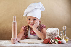 Little girl making pizza Stock Photo