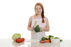 Little girl making a salad Royalty Free Stock Photography