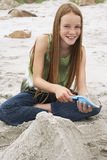 Little Girl Making Sand Castle At Beach Stock Images