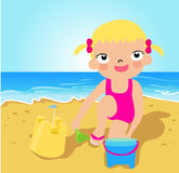 Little girl making sand castle at tropical beach Royalty Free Stock Images