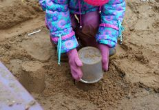 Little girl making sand pies. In the autumn Royalty Free Stock Photography
