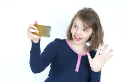 Little girl making a self mobile phone. Stock Photos