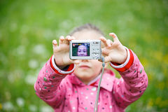Little girl making a selfie with digital camera Royalty Free Stock Photography