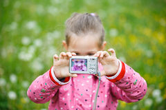 Little girl making a selfie with digital camera Stock Photography