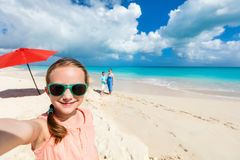 Mother and kids on a tropical beach Royalty Free Stock Photos