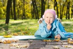 Little girl making shushing gesture Stock Photo
