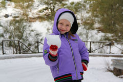 Little girl making snowballs Stock Photos
