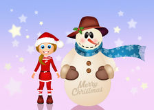 Little girl making snowman at Christmas Royalty Free Stock Photo