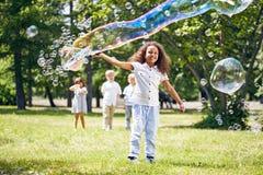 Little Girl Making Soap Bubbles stock image