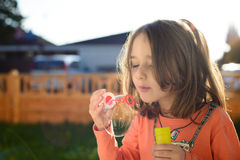 Little girl making soap bubbles Royalty Free Stock Photography