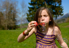 A little girl making soap bubbles Royalty Free Stock Photography
