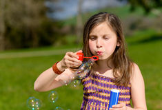 A little girl making soap bubbles Royalty Free Stock Photos