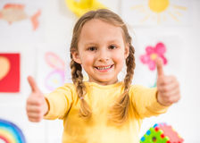 Little girl making thumbs up Royalty Free Stock Photo