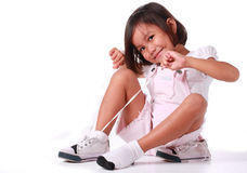 Little girl making a tie on her shoe Royalty Free Stock Photo